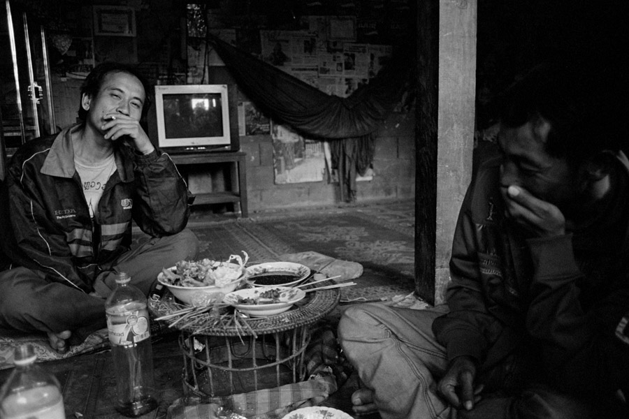 Nong Khiaw, Laos 2011: day drinking and snacking with some local dudes.