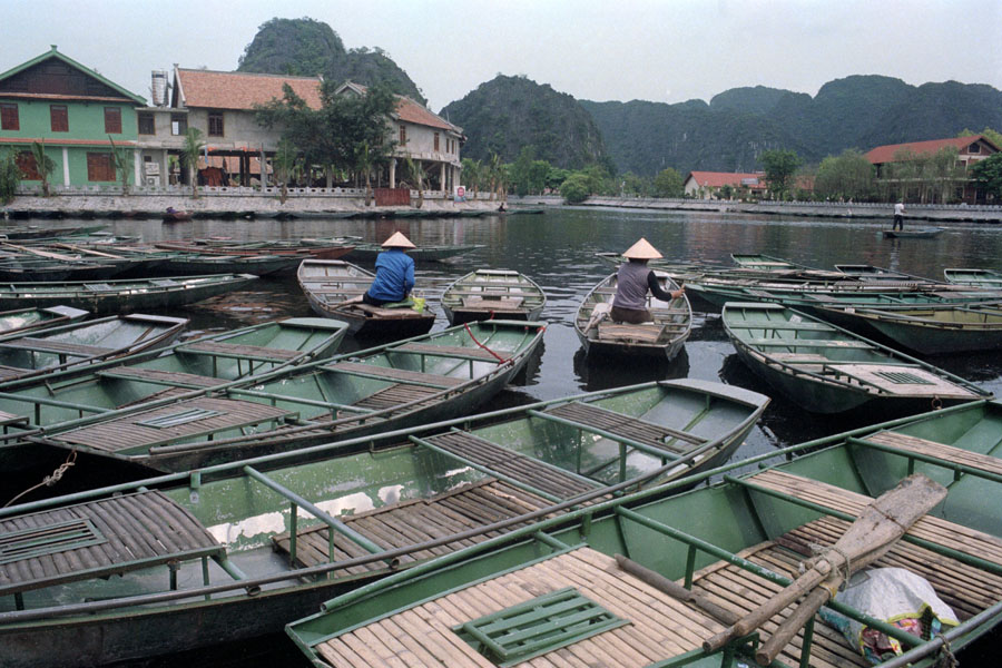 Tam Coc, Vietnam 2013: tourist boats piling up at the embarcardero.