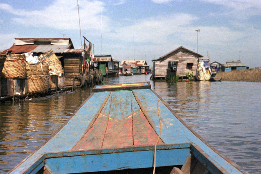 Kompong Luong, Cambodia 2012: houses near the edge of the village are on stilts, while those further in float and towed toward Tonle Sap's center during dry season. Boats are required for getting around.